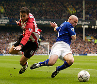 Photo. Jed Wee.<br /> Everton v Southampton, FA Barclaycard Premiership, Goodison Park, Liverpool. 19/10/03.<br /> Everton's Lee Carsley (R) and Southampton's Rory Delap go flying.