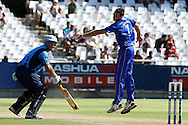 Pierre Joubert of the Titans and Johan Louw look on as the ball runs to the boundary during the Standard Bank Pro20 semi final match between the Nashua Mobile Cape Cobras and the Nashua Titans held at Sahara Park Newlands in Cape Town on the 27 February 2011..Photo by Ron Gaunt/SPORTZPICS