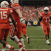 University of Houston quarterback, Greg Ward Jr., Celebrates an early touchdown with his teammates.<br /> <br /> Todd Spoth for The New York Times.