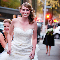 Erin's bridesmaids help her down the street before her Catholic wedding in Brooklyn, New York.