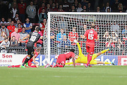York City goalkeeper Scott Flinders can't get to Mansfield Town forward Matt Green gaolbirds shot during the Sky Bet League 2 match between York City and Mansfield Town at Bootham Crescent, York, England on 29 August 2015. Photo by Simon Davies.