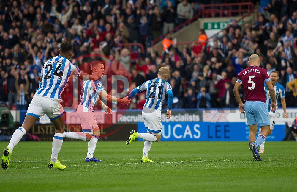 Alex Pritchard of Huddersfield Town (C) celebrates after scoring his sides first goal - Mandatory by-line: Jack Phillips/JMP - 10/11/2018 - FOOTBALL - The John Smith's Stadium - Huddersfield, England - Huddersfield Town v West Ham United - English Premier League