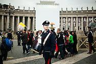 ROMA. UN GIOVANE CARABINIERE CONTROLLA IL FLUSSO DEI FEDELI IN PIAZZA SAN PIETRO ALLA VIGILIA DELLA BEATIFICAZIONE DI PAPA GIOVANNI PAOLO II;