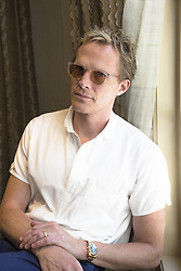 July 26, 2017 - Hollywood, California, U.S. - PAUL BETTANY stars in the TV series 'Manhunt: Unabomber.' Paul Bettany (born May 27, 1971) is an English actor. He is known for his voice role as J.A.R.V.I.S. and the Vision in the Marvel Cinematic Universe, specifically the films Iron Man (2008), Iron Man 2 (2010), The Avengers (2012), Iron Man 3 (2013), Avengers: Age of Ultron (2015) and Captain America: Civil War (2016), for which he garnered praise. He first came to the attention of mainstream audiences when he appeared in the British film Gangster No. 1 (2000), and director Brian Helgeland's film A Knight's Tale (2001). He has gone on to appear in a wide variety of films, including A Beautiful Mind (2001), Master and Commander: The Far Side of the World (2003), Dogville (2003), Wimbledon (2004), and the adaptation of the novel The Da Vinci Code (2006). Avengers: Infinity War (2018), Manhunt: Unabomber (2017 TV Series), Journey's End (2017). (Credit Image: © Armando Gallo via ZUMA Studio)
