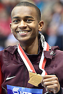 Mutaz Essa Barshim of Qatar with his gold medal and World Champion title after men's high jump final while medal ceremony during the IAAF Athletics World Indoor Championships 2014 at Ergo Arena Hall in Sopot, Poland.<br /> <br /> Poland, Sopot, March 9, 2014.<br /> <br /> Picture also available in RAW (NEF) or TIFF format on special request.<br /> <br /> For editorial use only. Any commercial or promotional use requires permission.<br /> <br /> Mandatory credit:<br /> Photo by © Adam Nurkiewicz / Mediasport