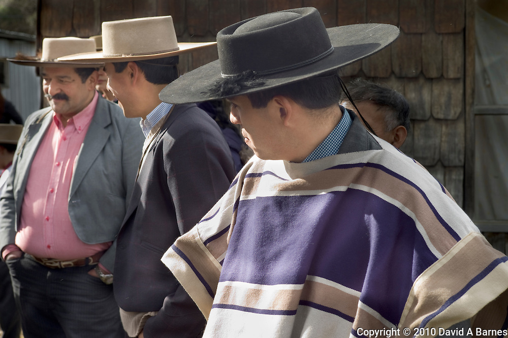 Men in sobreros talking, Chile