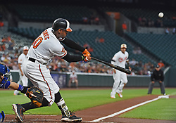 August 31, 2017 - Baltimore, MD, USA - The Baltimore Orioles' Adam Jones swings for a home run with teammate Manny Machado, right, on third base against the Toronto Blue Jays in the first inning at Oriole Park at Camden Yards in Baltimore on Thursday, Aug. 31, 2017. The Blue Jays won, 11-8. (Credit Image: © Kenneth K. Lam/TNS via ZUMA Wire)