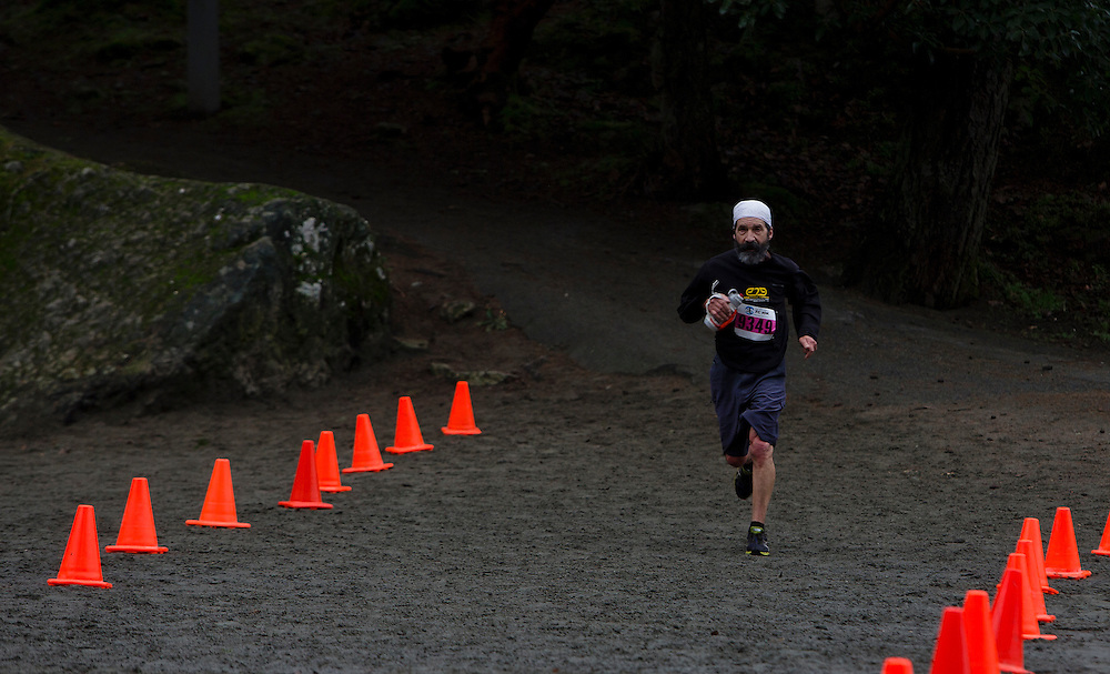 VICTORIA B.C. - DECEMBER 13:  Carlos Castillo of the Prairie Inn Harriers competes in the 10 mile Stewart Mountain X-Country Challenge on December 13, 2014 at Thetis Lake Park in Victoria, British Columbia Canada. Castillo finished ninth in the male 50-59 division with a time of 1:59:28. (Photo by Kevin Light)