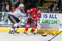KELOWNA, CANADA - APRIL 25: Madison Bowey #4 of the Kelowna Rockets checks Brendan Leipsic #28 of the Portland Winterhawks as he makes a pass on April 25, 2014 during Game 5 of the third round of WHL Playoffs at Prospera Place in Kelowna, British Columbia, Canada. The Portland Winterhawks won 7 - 3 and took the Western Conference Championship for the fourth year in a row earning them a place in the WHL final.  (Photo by Marissa Baecker/Getty Images)  *** Local Caption *** Madison Bowey; Brendan Leipsic;