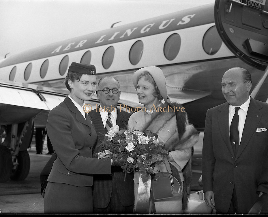 08/06/1957<br /> 06/08/1957<br /> 08 June 1957<br /> <br /> Herbert Wilcox (centre) and Anna Neagle are welcomed by an Air Lingus steward at Dublin Airport<br /> <br /> <br /> Dame Anna Neagle, DBE (20/10/1904 &ndash; 03/06/1986), born Florence Marjorie Robertson, was a popular British stage and motion picture actress and singer.<br />
