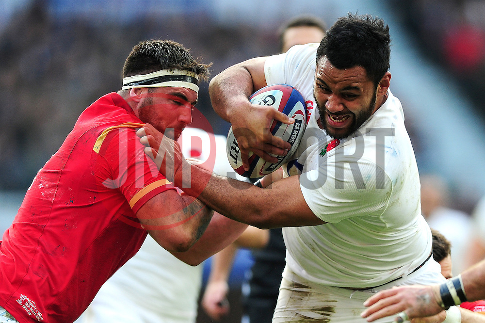 Billy Vunipola of England is tackled by Scott Baldwin of Wales - Mandatory byline: Patrick Khachfe/JMP - 07966 386802 - 12/03/2016 - RUGBY UNION - Twickenham Stadium - London, England - England v Wales - RBS Six Nations.