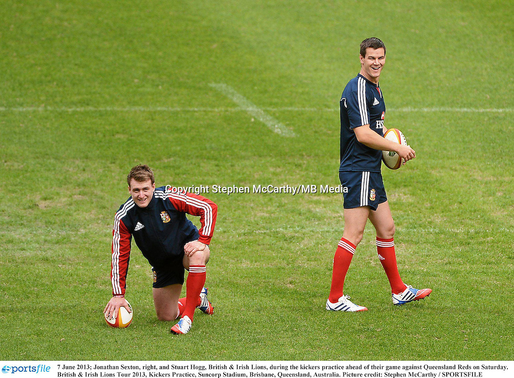 7 June 2013; Jonathan Sexton, right, and Stuart Hogg, British & Irish Lions, during the kickers practice ahead of their game against Queensland Reds on Saturday. British & Irish Lions Tour 2013, Kickers Practice, Suncorp Stadium, Brisbane, Queensland, Australia. Picture credit: Stephen McCarthy / SPORTSFILE