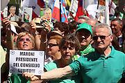 """Supporters of Lega Nord (North League party) show photos of Umberto Bossi at Pontida meeting, June 19, 2011. Placard read """"Maroni Prime minister now"""". © Carlo Cerchioli..Militanti della Lega Nord mostrano foto di Umberto Bossi al raduno di Pontida, 19 giugno 2011."""