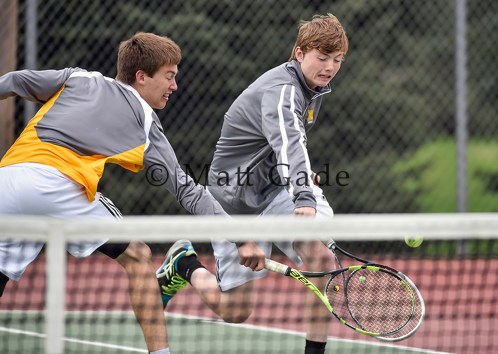 Mitchell's Jared Suelflow, right, and Baley Miller both chase down a shot during No. 3 doubles action during a dual against Brookings on Tuesday at Hitchcock Park in Mitchell. (Matt Gade/Republic)