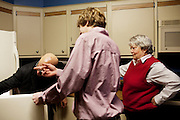 Linda Groeber watches as her grandson Evan Brown, 13, and her son-in-law Michael Molanphy search her refrigerator in Lutherville-Timonium, Maryland on Wednesday, January 13, 2010. As she ages Linda has relied more on her family to help with day-to-day tasks.