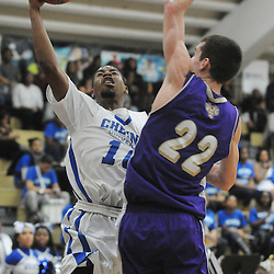 Staff photos by Tom Kelly IV<br /> Cheyney's Jarrod Johnson (10) goes up for a layup against West Chester's Matt Wisely (22) during the men's basketball game between West Chester and Cheyney, at Cheyney University, Wednesday night January 29, 2014.