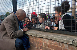 Chuka Umunna MP for Streatham and Shadow Secretary of State for Business, Innovation and Skills, Signing autographs for local schoolchildren, London, UK, 24 February, 2013. Photo by i-Images...