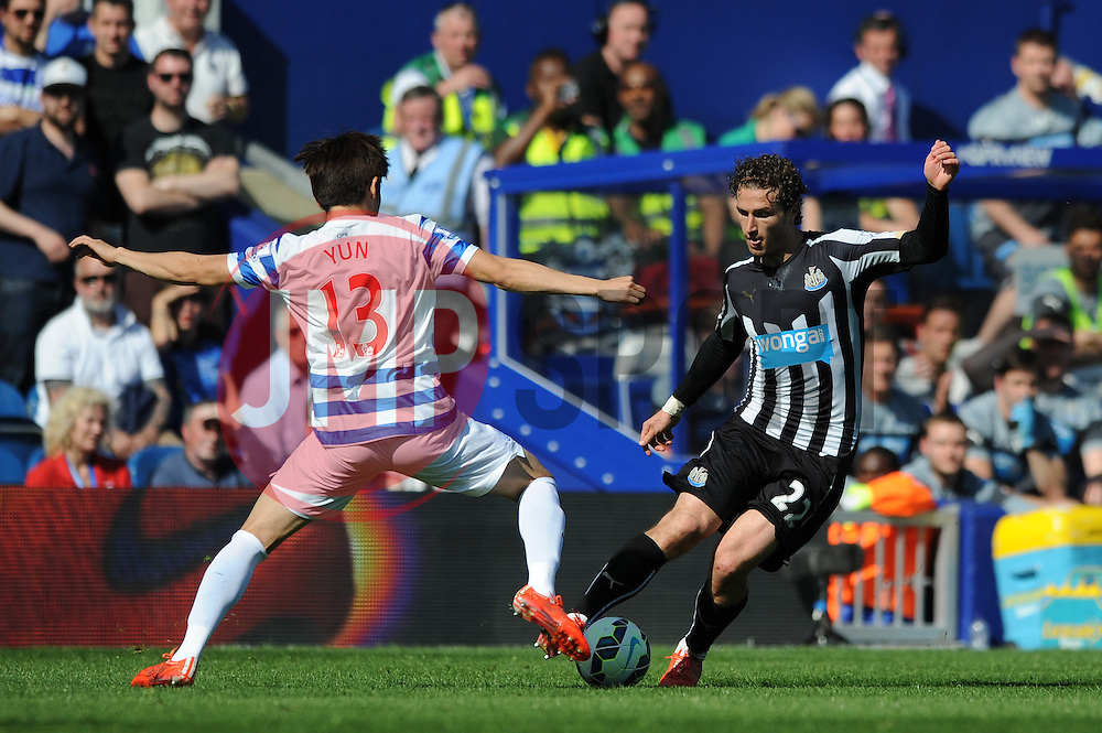 Newcastle United's Daryl Janmaat is challenged by Queens Park Rangers' Yoon Suk-Young - Photo mandatory by-line: Dougie Allward/JMP - Mobile: 07966 386802 - 16/05/2015 - SPORT - football - London - Loftus Road - QPR v Newcastle United - Barclays Premier League