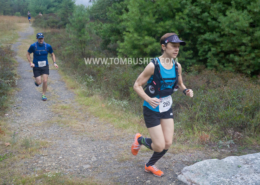 Kerhonkson, New York - Eventual winner Laura Kline and Ian Schwartz run through Minnewaska State Park Preserve during the Shawangunk Ridge Trail Run/Hike 20-mile race on Sept. 20, 2014.