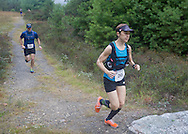 Kerhonkson, New York - Eventual winner Laura Kline and Ian Schwartz run through Minnewaska State Park Preserve during the Shawangunk Ridge Trail Run/Hike 20-mile race on Sept. 20, 2014.