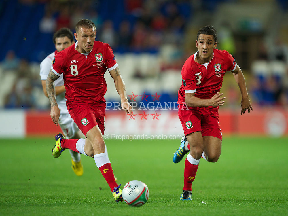 CARDIFF, WALES - Friday, September 2, 2011: Wales' Craig Bellamy and Neil Taylor in action against Montenegro during the UEFA Euro 2012 Qualifying Group G match at the  Cardiff City Stadium. (Pic by David Rawcliffe/Propaganda)