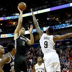 Jan 20, 2017; New Orleans, LA, USA; Brooklyn Nets center Brook Lopez (11) shoots over New Orleans Pelicans forward Terrence Jones (9) during the second half of a game at the Smoothie King Center. The Nets defeated the Pelicans 143-114. Mandatory Credit: Derick E. Hingle-USA TODAY Sports