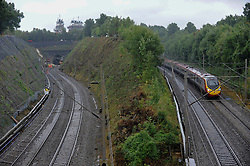© Licensed to London News Pictures. 16/09/2016. Watford, UK. A train has derailed following a landslide close to Hunton Bridge just outside Watford in north west London.  Network Rail engineers are in attendance.  The 6:19am from Milton Keynes to London Euston train is reported to have struck a landslide, clipped a train travelling in the opposite direction causing it to become stuck in the tunnel (top left).  Photo credit : Stephen Chung/LNP