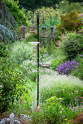 Bird feeder with feeders for nuts, seeds and fat balls