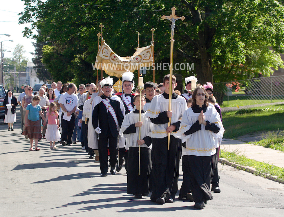 Middletown, NY - Altar boys lead a procession from St. Joseph's Church down Coattage Street on the feast of Corpus Christi, May 25, 2008.