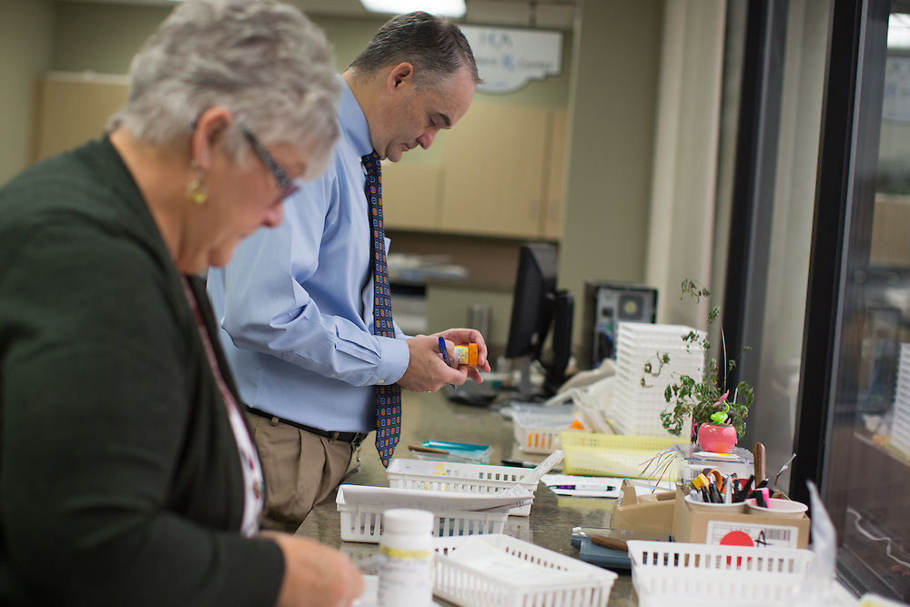 Michael Reff, RPh, MBA, right, works alongside Deborah Walters, RN, OCN, at The Patient Rx Center at Hematology-Oncology Associates of Central New York in East Syracuse, New York on Monday, October 24, 2016. CREDIT: Mike Bradley for the Wall Street Journal<br /> CANCERPILLS