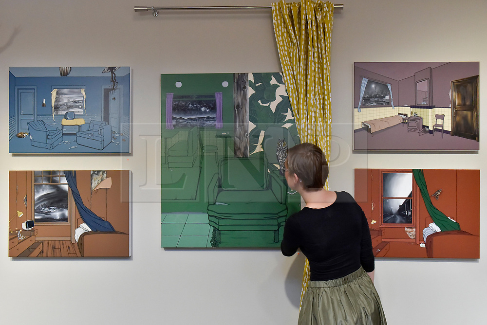 © Licensed to London News Pictures. 06/10/2017. London, UK.  A woman views a collection of works by Vanessa Smith at the Moniker Art Fair, the world's biggest urban art fair, taking place at the Old Truman Brewery in East London from 5 to 8 October 2017.  The fair brings together the world's most influential new-contemporary and urban art galleries to show international artworks to Londoners. Photo credit : Stephen Chung/LNP