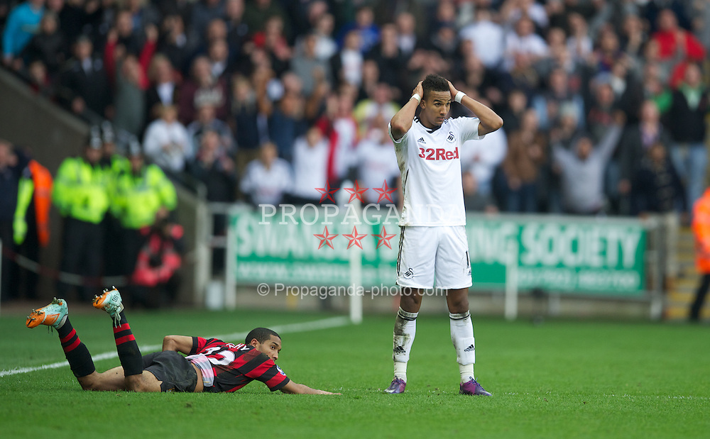 SWANSEA, WALES - Sunday, March 11, 2012: Swansea City's Scott Sinclair looks dejected after trying to score from the half-way line as the Manchester City players and goalkeeper swarm forward in injury time during the Premiership match at the Liberty Stadium. (Pic by David Rawcliffe/Propaganda)