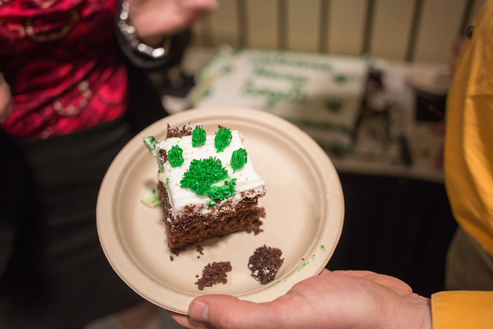 Mike Snavely holds up a piece of cake to be served at the College of Business's reception following a day of training with Sogeti on March 10, 2016. Photo by Emily Matthews