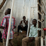 Burundian university students, seeking shelter outside the US embassy in Bujumbura, socialise near a vacant building close by. The students moved to the area in early May because, they claim, the US authorities ensure their security, after their university was closed amid anti-government protests. The government closed the university at the end of April, citing ìinsecurityî.