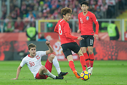 March 27, 2018 - Chorzow, Poland - Taras Romanczuk of Poland vies Jae-sung Lee (KOR), Heung-min Son (KOR),   during the international friendly soccer match between Poland and South Korea national football teams, at the Silesian Stadium in Chorzow, Poland on 27 March 2018. (Credit Image: © Foto Olimpik/NurPhoto via ZUMA Press)