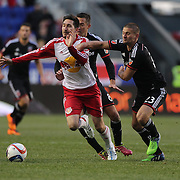Sacha Kljestan, (left), New York Red Bulls, is fouled by Perry Kitchen, D.C. United, during the New York Red Bulls Vs D.C. United, Major League Soccer regular season opening match at Red Bull Arena, Harrison, New Jersey. USA. 22nd March 2015. Photo Tim Clayton