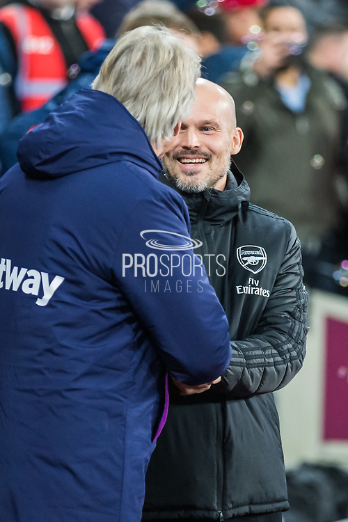 Manuel Pelligrini, Manager of West Ham FC greeting Freddie Ljungberg, Head Coach of Arsenal FC before the Premier League match between West Ham United and Arsenal at the London Stadium, London, England on 9 December 2019.