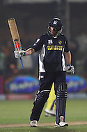 David Hussey of the Victorian Bushrangers raises his bat after reaching his fifty during match 13 of the Airtel CLT20 between The Superkings and the Victorian Bushrangers held at St Georges Park in Port Elizabeth on the 18 September 2010..Photo by: Shaun Roy/SPORTZPICS/CLT20