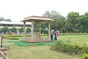 India, Delhi, Mahatma Gandhi Memorial at the site of his assassination in 1948 Local people paying homage to the murdered leader