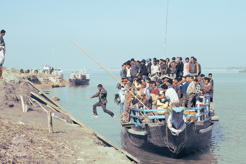 A man jumps off the Majuli island ferry near Jorhat, Assam, India.<br /> <br /> Majuli is the largest sand river island in the world and lies in the middle of the Bhramaputra, one of India's major waterways.