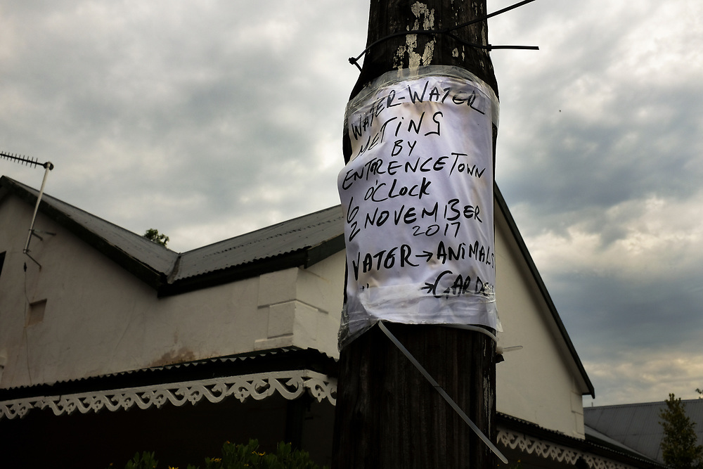 Sign announcing a meeting about water, gardens and animals on a light pole, Mcgregor. Many small towns close to the Cape Town Metropol, like McGregor, are experiencing water rationing although the local dams are full. This is so that the water can be trucked to Cape town in an emergency.