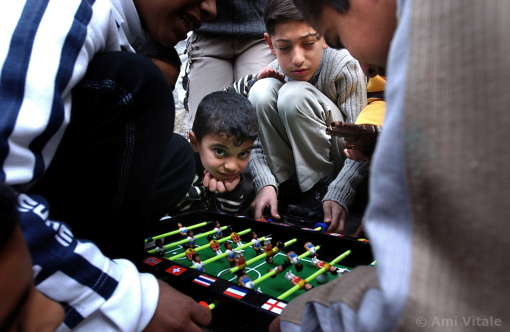NABLUS, WEST BANK, FEB. 11, 2003: Palestinian children play with their new toys on the Muslim holiday of Eid al-Adha (Feast of Sacrifice) in the West Bank city of Nablus,  February 10, 2003.(Ami Vitale/Getty Images)
