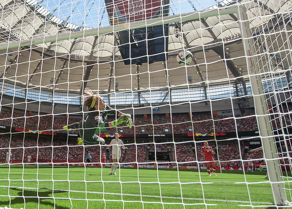 Gaelle Thalmann of team Switzerland dives for the ball that hit off the post in 2015 women's World Cup Soccer in Vancouver during second round action between Canada and Switzerland