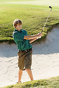 Golfer Standing in Sand Trap