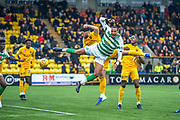 Christopher Jullien (#2) of Celtic FC and Ricki Lamie (#5) of Livingston FC jump for a header in the box during the Ladbrokes Scottish Premiership match between Livingston FC and Celtic FC at The Tony Macaroni Arena, Livingston, Scotland on 6 October 2019.
