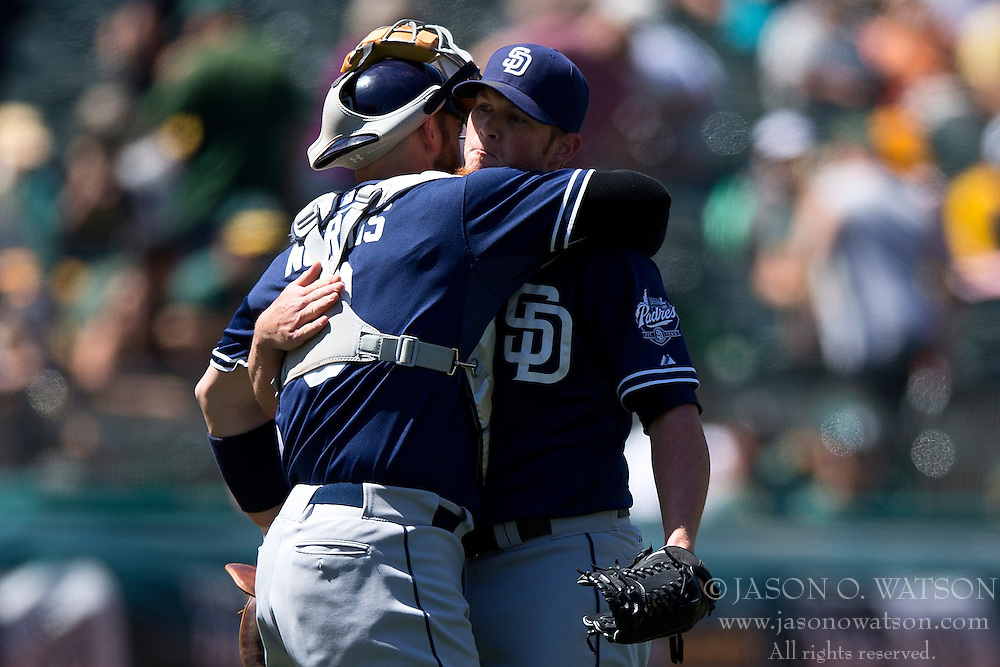 OAKLAND, CA - JUNE 18:  Craig Kimbrel #46 of the San Diego Padres hugs Derek Norris #3 after the game against the Oakland Athletics at O.co Coliseum on June 18, 2015 in Oakland, California. The San Diego Padres defeated the Oakland Athletics 3-1. (Photo by Jason O. Watson/Getty Images) *** Local Caption *** Craig Kimbrel; Derek Norris