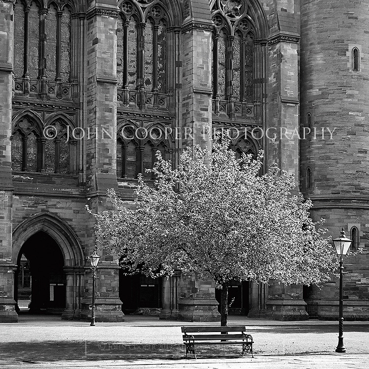 Black and White photograph of the West Quadrangle at University of Glasgow. Mounted print available to purchase.