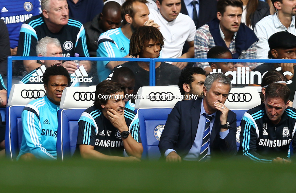 13 September 2014 - Barclays Premier League - Chelsea v Swansea City - Loic Remy of Chelsea looks on from the substitutes bench behind Jose Mourinho - Photo: Marc Atkins / Offside.