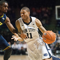 Penn State's Jermaine Marshall (11) drives to the basket with Michigan's Tim Hardaway Jr. (10) defending in the first half of an NCAA basketball game in Unversity Park, Pa., Wedneday, February 27, 2013.