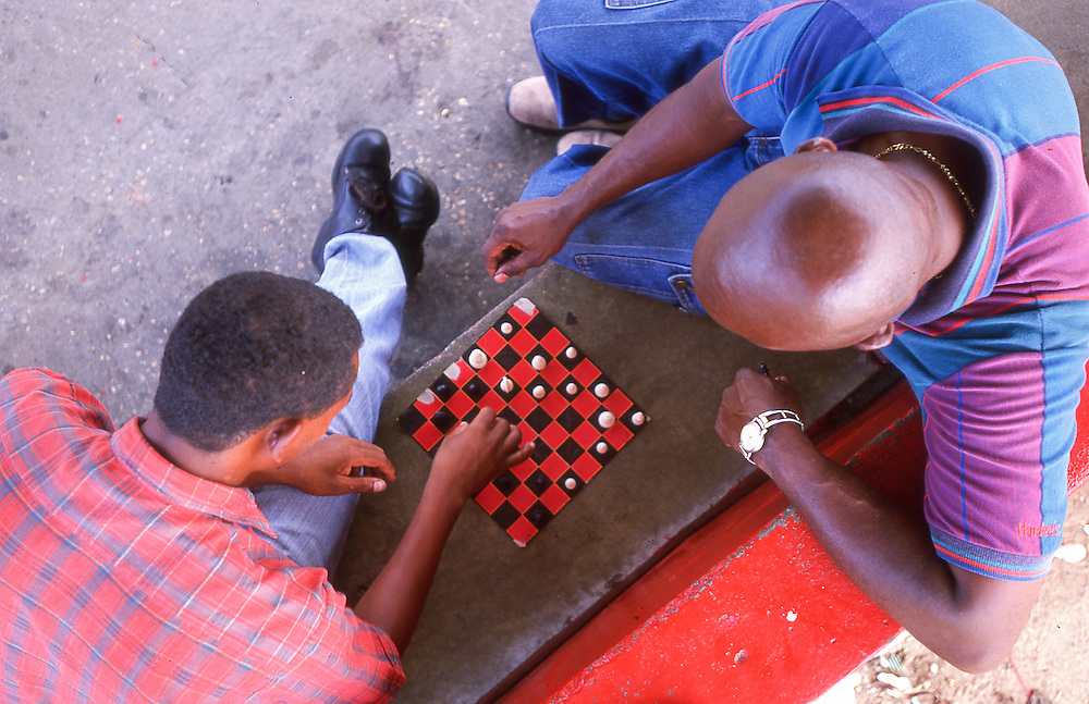 Overhead view of local Portobelo men playing chess.